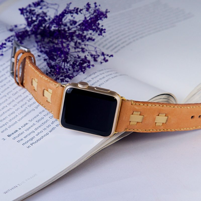 leather apple watch band and book