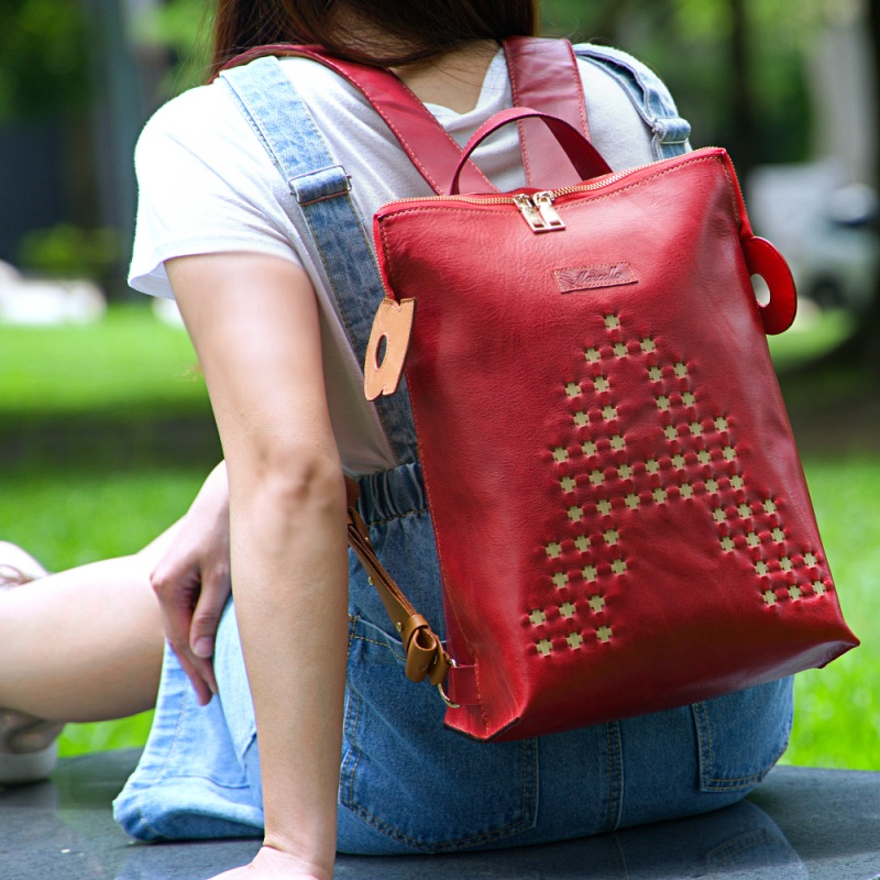 red backpack purse model sitting